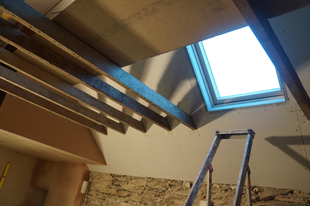 Newly installed skylight and a ladder