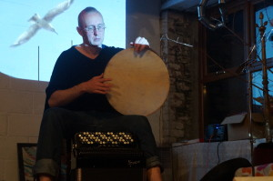 A man plays a hand drum