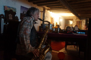 A woman plays sax